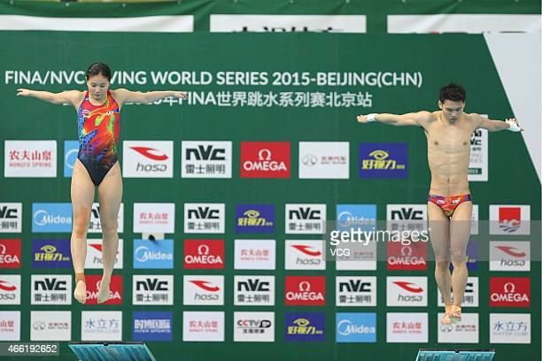 He Zi and Chen Aisen of China compete in the Mixed diving 3 m platform on day two of FINA/NVC Diving World Series 2015 at National Aquatics Center on...