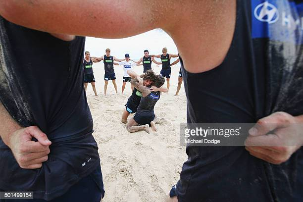 Heach coach Brendon Bolton and team watch Dylan Buckley and Clem Smith wrestle during a circuit training session at Kurrawa Beach during the Carlton...