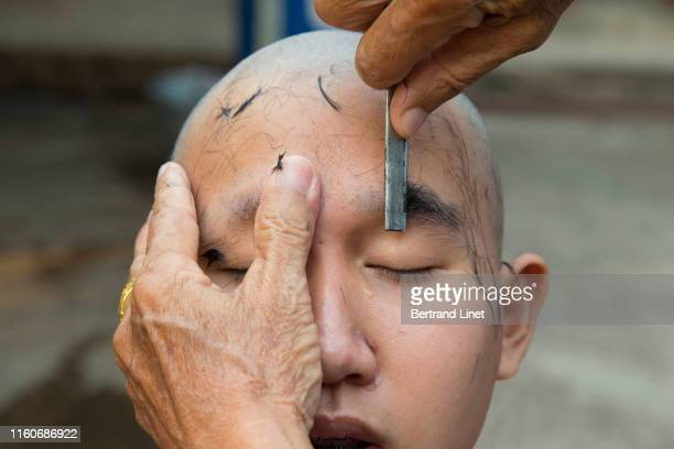 head and eyebrow shaving ceremony in thailand - religious event stock pictures, royalty-free photos & images