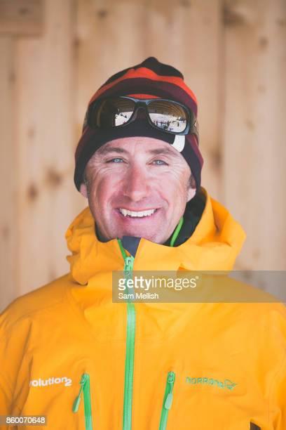 Head and shoulder portrait of a male skier outside a traditional woodedn chalet Refuge De Bostan in Vallée de la Manche in Morzine / Portes du Soleil...