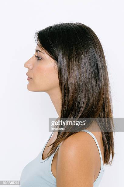 Head and shoulder side profile of young woman wearing vest