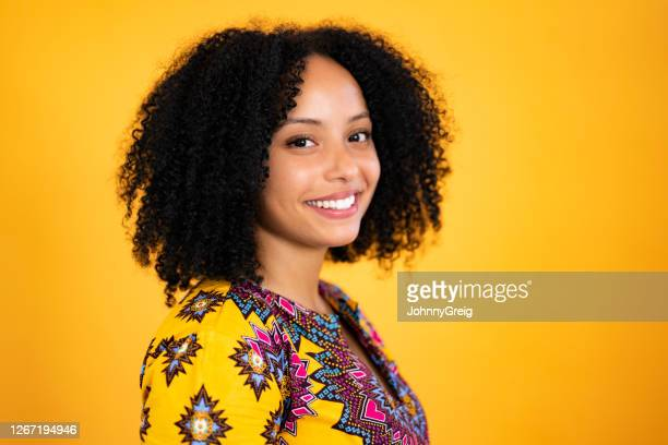 head and shoulder view of young black woman in casual top - traditional clothing stock pictures, royalty-free photos & images