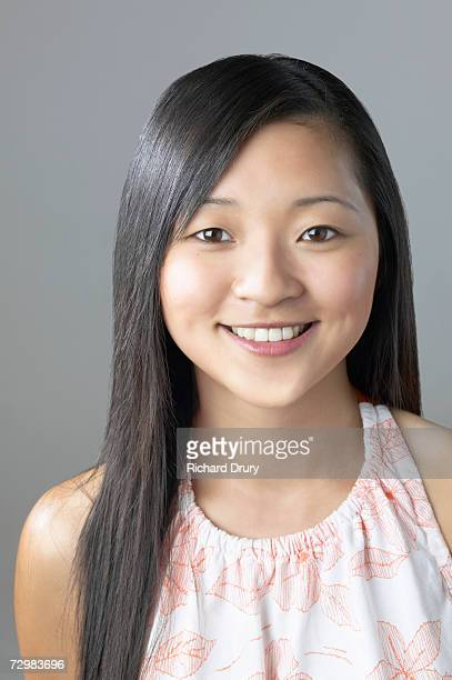 head and shoulders of young woman smiling, portrait - richard drury stock pictures, royalty-free photos & images