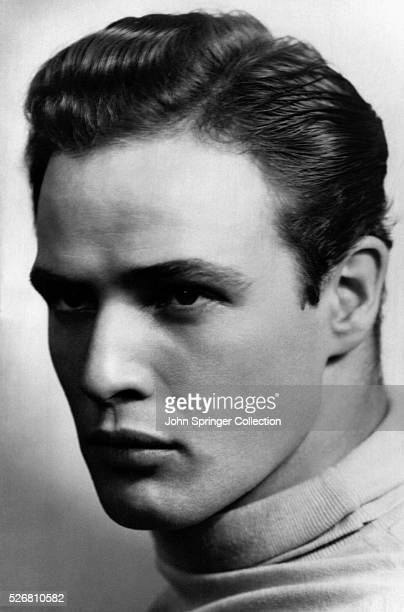 Head and shoulders photo of young American actor Marlon Brando staring intentily Ca 1950s