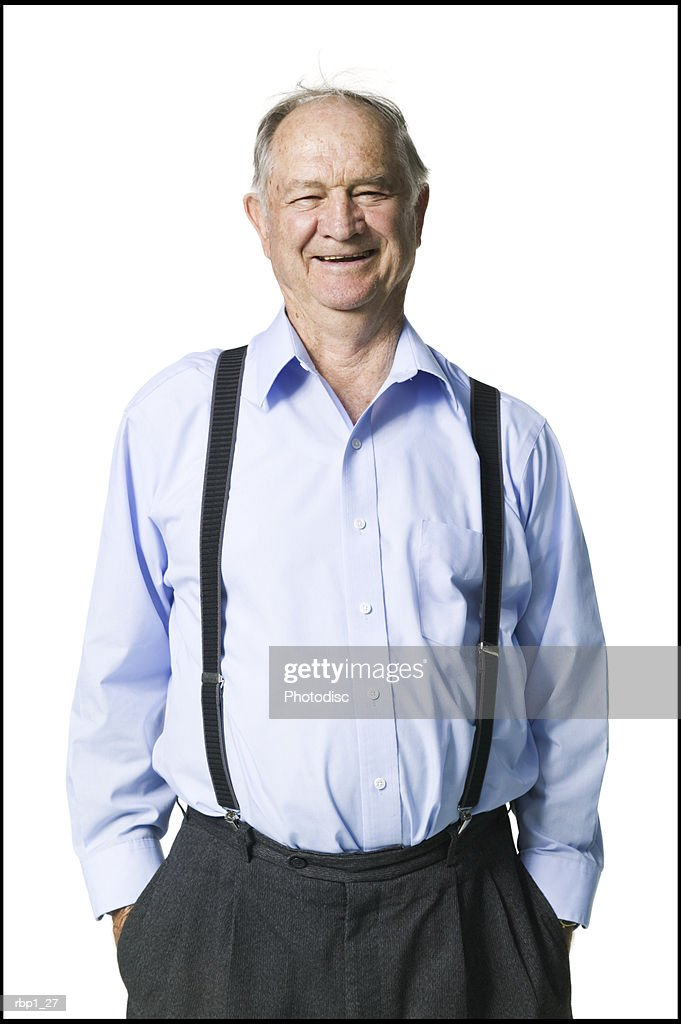 head and shoulders portrait of a senior adult male in a blue shirt and suspenders as he smiles : Stockfoto