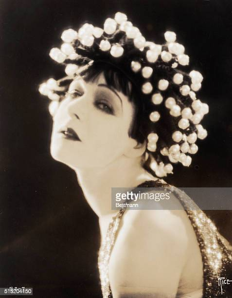 Head and shoulders portrait of Alla Nazimova actress from the Ukraine who gained fame starring in Broadway productions starting with the title role...
