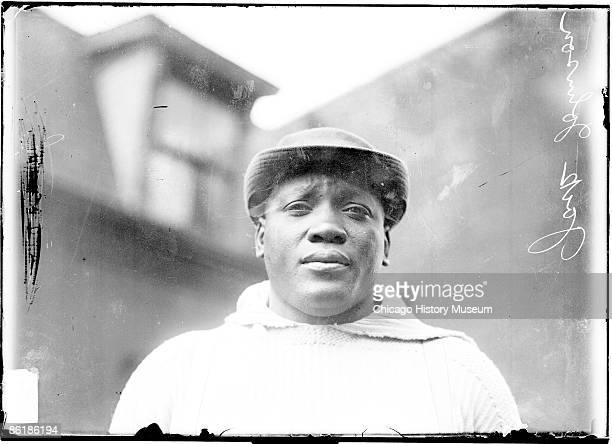 Head and shoulders portrait of legendary world heavyweight champion Jack Johnson standing outdoors in Chicago IL 1910 Johnson was the first African...