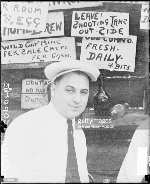 Head and shoulders portrait of Ralph Capone brother of mob boss Al Capone looking toward the camera standing in front of a food stand in Chicago...