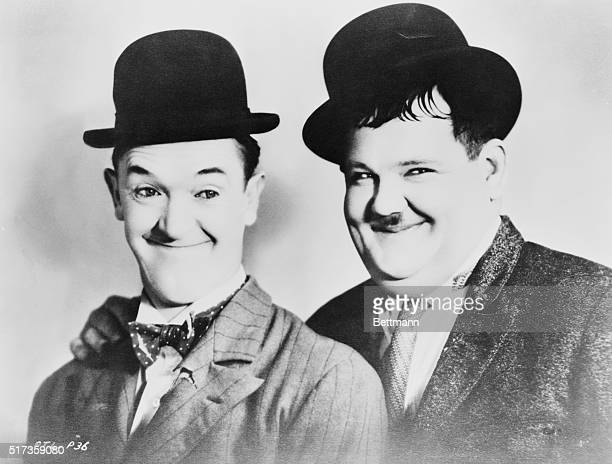Head and shoulders portrait of Stan Laurel and Oliver Hardy wearing derby hats Undated photograph