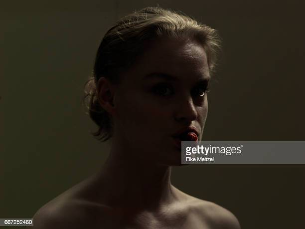 head and shoulders portrait of woman in darkness