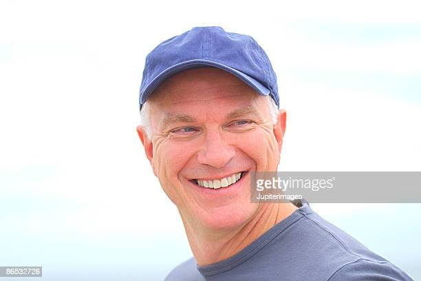 Head and shoulders shot of smiling middle-aged man