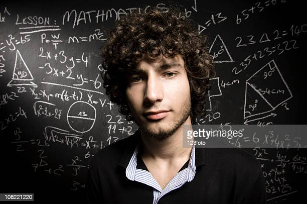 Head and Shoulders Shot of Young Man with Blackboard