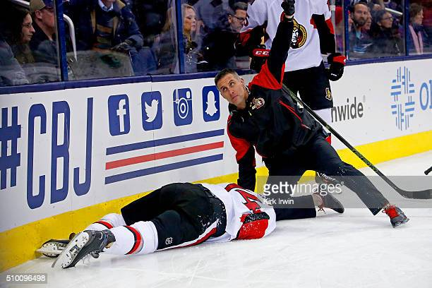 Head athletic therapist Gerry Townend of the Ottawa Senators signals for medical attention while tending to Mark Borowiecki of the Ottawa Senators...