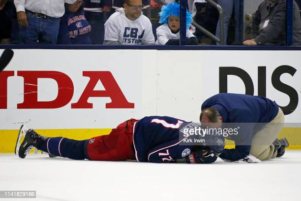 Head athletic trainer Mike Vogt checks on Josh Anderson after being hit in the head by Charlie McAvoy of the Boston Bruins during the second period...