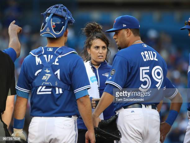 Head athletic trainer Nikki Huffman comes out to the mound to check on Rhiner Cruz of the Toronto Blue Jays who would leave the game with an injury...