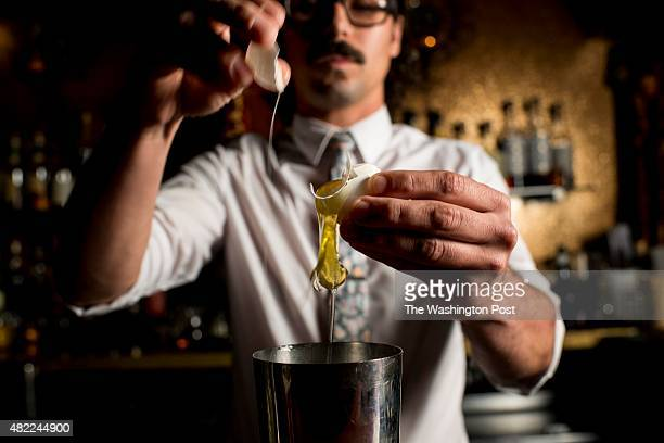 PHILADELPHIA PENNSYLVANIA Head bartender Derek Moorer creates a cocktail at The Ranstead Room at an out of the way speakeasy Friday evening in...
