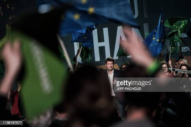 Head candidate of French ecologist party Europe Ecologie Les Verts Yannick Jadot acknowledges the audience after delivering a speech on stage during...