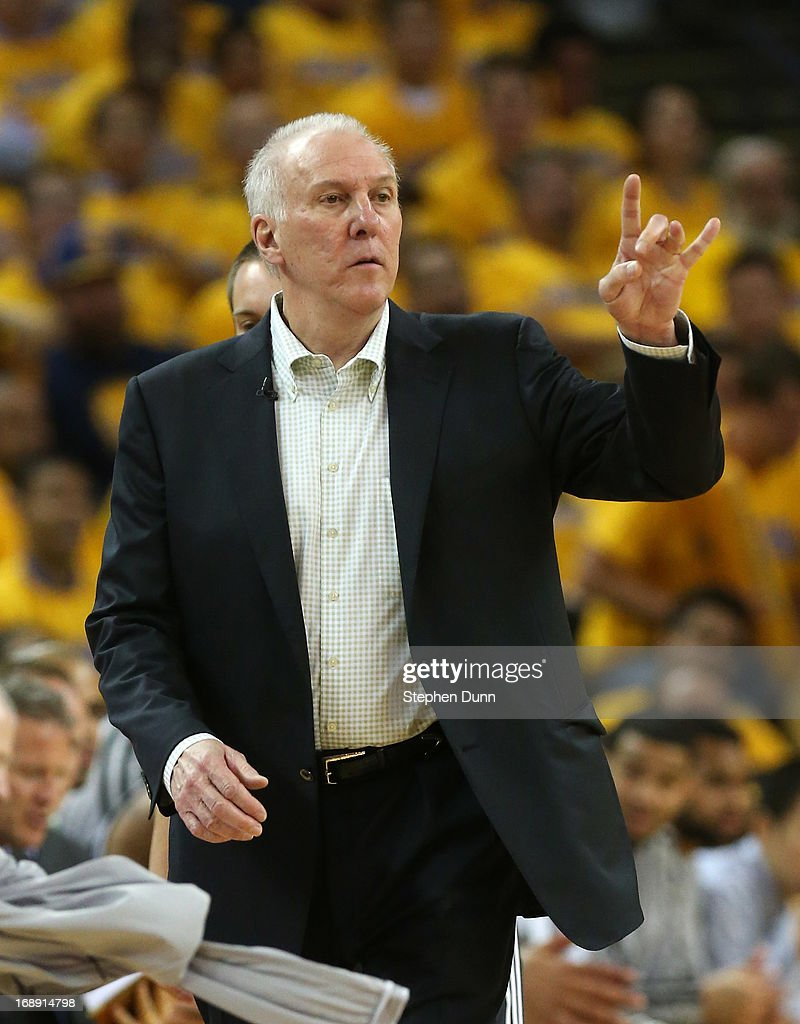 Head caoch Gregg Popovich of the the San Antonio Spurs signals against the Golden State Warriors in Game Six of the Western Conference Semifinals during the 2013 NBA Playoffs on May 16, 2013 at the Oracle Arena in Oakland, California. The Spurs won 94-82 to take the series 4-2. .