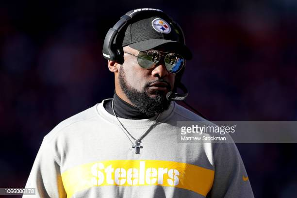 Head caoch Mike Tomlin of the Pittsburgh Steelers walks on the fiield during warmups before playing the Denver Broncos at Broncos Stadium at Mile...