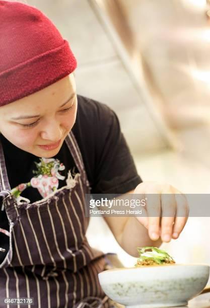 Head chef Cara Stadler adds fresh garnish to her dish Mapo Tofu at Tao Yuan