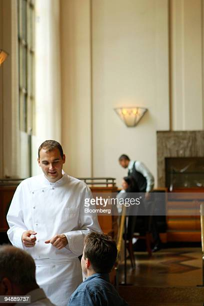 Head chef Daniel Humm speaks with patrons during lunch service at Eleven Madison Park a restaurant located at 11 Madison Avenue in New York US on...