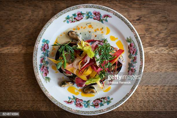 TORONTO ON APRIL 15 Head chef Duncan Simpson prepares mussels on toast with house made white bread mussels steamed with cider and cream finished with...