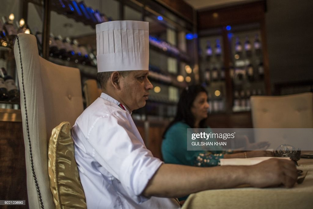 Head Chef of Geet Restaurant Kamal Singh, who worked in the restaurant for five year, poses in Pretoria on February 20, 2018. The restaurant is the choice caterer for the Indian cricket team during their visits to play in South Africa. /