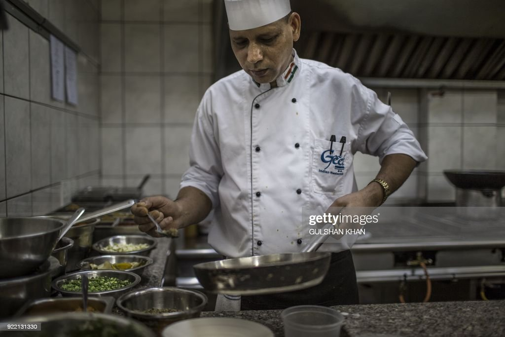Head Chef of Geet Restaurant Kamal Singh, who worked in the restaurant for five years, cooks in the kitchen in Pretoria on February 20, 2018. The restaurant is the choice caterer for the Indian cricket team during their visits to play in South Africa. /