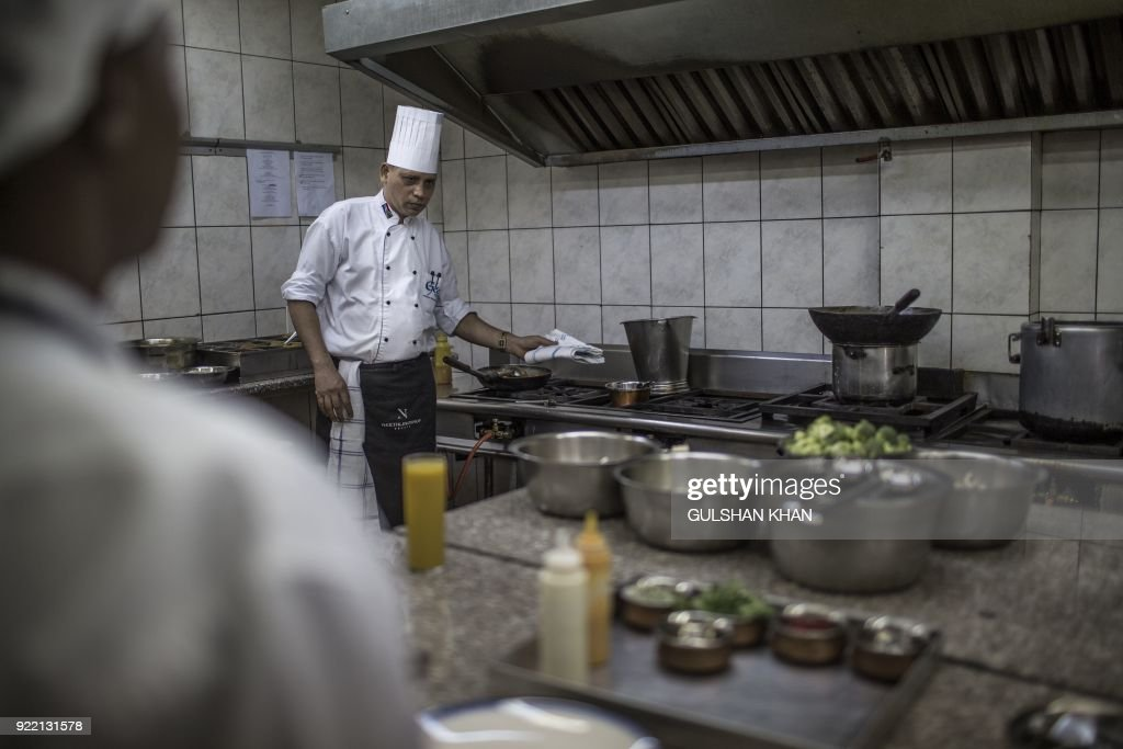 Head Chef of Geet Restaurant Kamal Singh, who worked in the restaurant for five years, cooks in the kitchen of the restaurant in Pretoria on February 20, 2018. The restaurant is the choice caterer for the Indian cricket team during their visits to play in South Africa. /