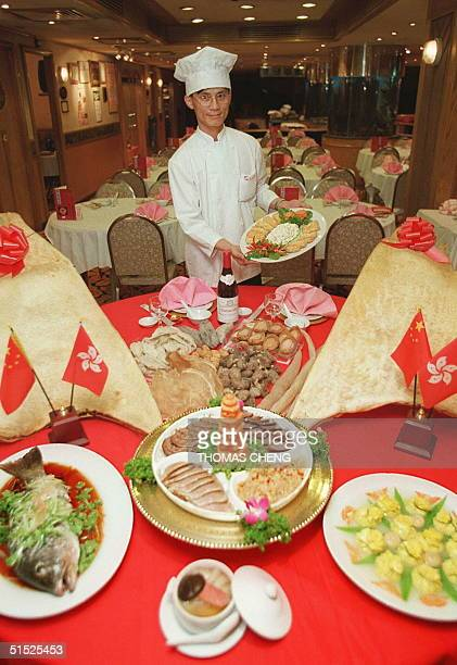 Head chef of the Floata Chiuchow Restaurant Joe Lau shows some of the dishes of the 1997Menu 19 April The HK$1997 eightcourse banquet includes a cold...