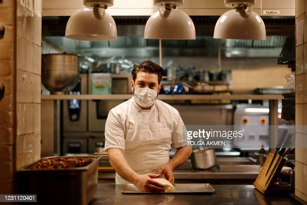 Head chef Rob Chambers poses as he assists in the preparation of packaged meals for the Luca at Home 'Valentines Menu for 2' at Luca restaurant in...