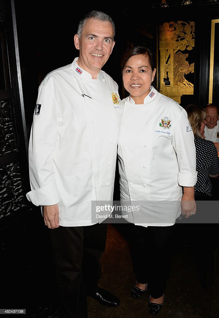 Head Chef to the UK Royal household Mark Flanagan and White House Executive Chef Cristeta Pasia Comerford attend Le Club des Chefs des Chefs dinner at Hakkasan Hanway Place on July 20, 2014 in London, England.