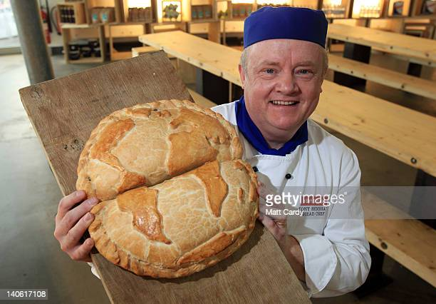 Head chef Tony Henshaw poses for a photograph with a giant pasty shaped as the globe at the World Cornish Pasty Championships at The Eden Project on...