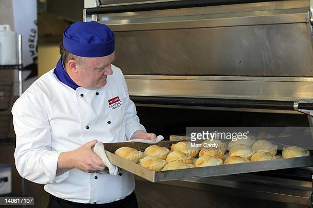 Head chef Tony Henshaw takes freshly baked pasties out of the oven at the World Cornish Pasty Championships at The Eden Project on March 3 2012 in St...