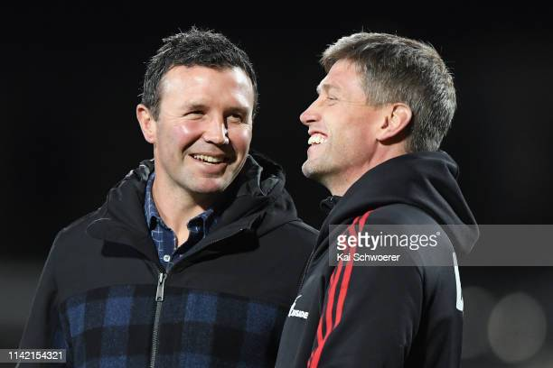 Head Coach Aaron Mauger of the Highlanders and Assistant Coach Ronan O'Gara of the Crusaders react prior to the round 9 Super Rugby match between the...