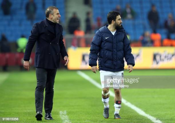 Head coach Abdullah Avci and player Arda Turan of Medipol Basaksehir look on during a Turkish Super Lig match between Trabzonspor and Medipol...