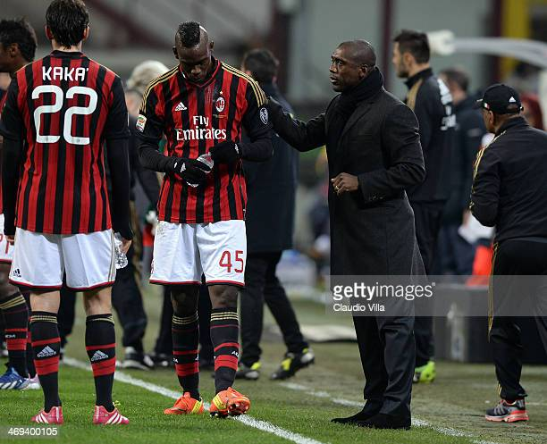 Head coach AC Milan Clarence Seedorf and Mario Balotelli talk during the Serie A match between AC Milan and Bologna FC at San Siro Stadium on...