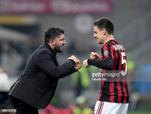 Head coach AC Milan Gennaro Gattuso and Giacomo Bonaventura celebrate during the Serie A match between AC Milan and Bologna FC at Stadio Giuseppe...