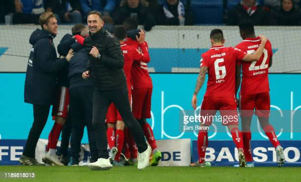 Head coach Achim Beierlorzer of Mainz celebrates during the Bundesliga match between TSG 1899 Hoffenheim and 1. FSV Mainz 05 at PreZero-Arena on...