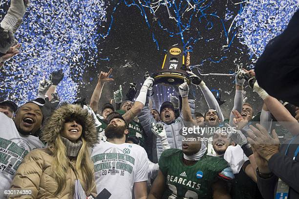 Head Coach Adam Dorrel of Northwest Missouri State University raises the Championship Trophy with his team following the Division II Men's Football...
