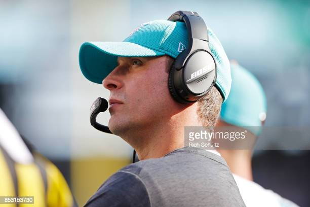 Head coach Adam Gase of the Miami Dolphins looks on against the New York Jets during the second half of an NFL game at MetLife Stadium on September...