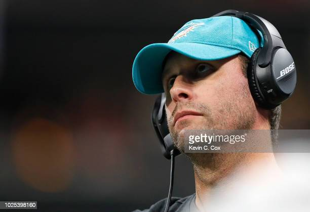 Head coach Adam Gase of the Miami Dolphins looks on during the game against the Atlanta Falcons at MercedesBenz Stadium on August 30 2018 in Atlanta...