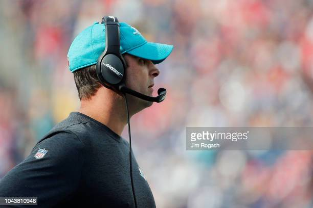 Head coach Adam Gase of the Miami Dolphins looks on during the game against the New England Patriots at Gillette Stadium on September 30 2018 in...