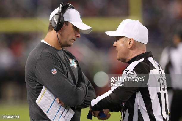Head Coach Adam Gase of the Miami Dolphins talks with referee John Parry after a play in the third quarter against the Baltimore Ravens at MT Bank...