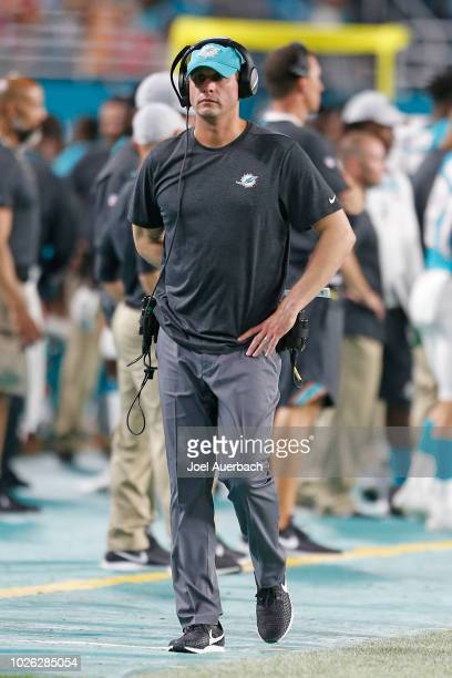 Head coach Adam Gase of the Miami Dolphins walks along the sideline during fourth quarter action against the Baltimore Ravens during a preseason NFL...