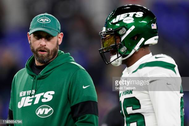 Head coach Adam Gase of the New York Jets and running back Le'Veon Bell talk before the game against the Baltimore Ravens at M&T Bank Stadium on...