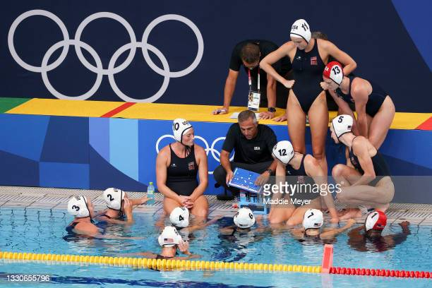Head Coach Adam Krikorian of Team United States talks to his team during the Women's Preliminary Round Group B match between the United States and...