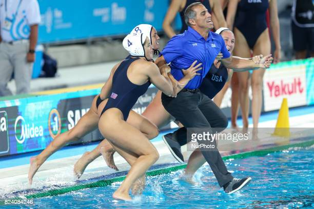 Head coach Adam Krikorian of the United States celebrates with his players following their team's 136 victory during the Women's Water Polo gold...