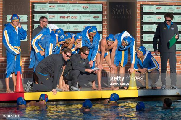 Head coach Adam Wright of the University of California Los Angeles instructs his team during the Division I Men's Water Polo Championship held at the...