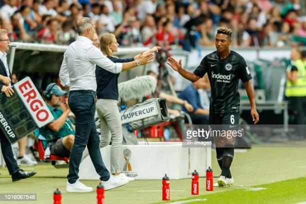 Head coach Ade Huetter of Eintracht Frankfurt and Jonathan de Guzman of Eintracht Frankfurt slap hands during the DFL Supercup match between...
